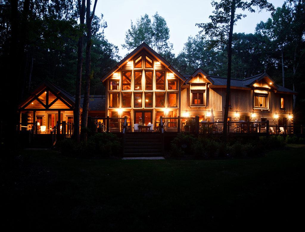 beaver mountain log homes heron cove log home nightime