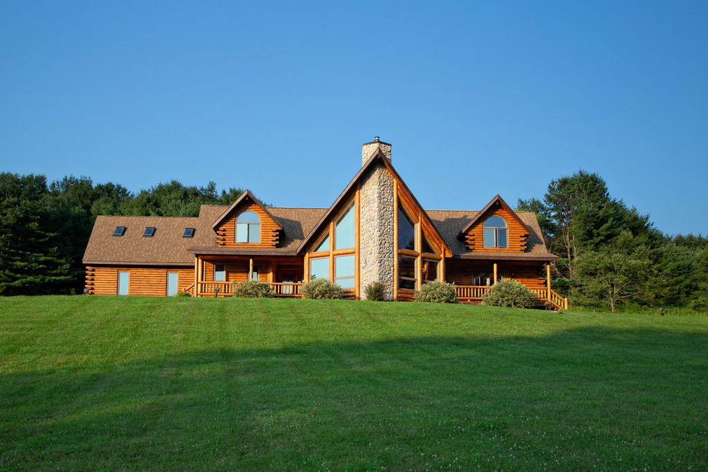 Beaver Mountain Log Homes Grandview Model Home Exterior Sunset
