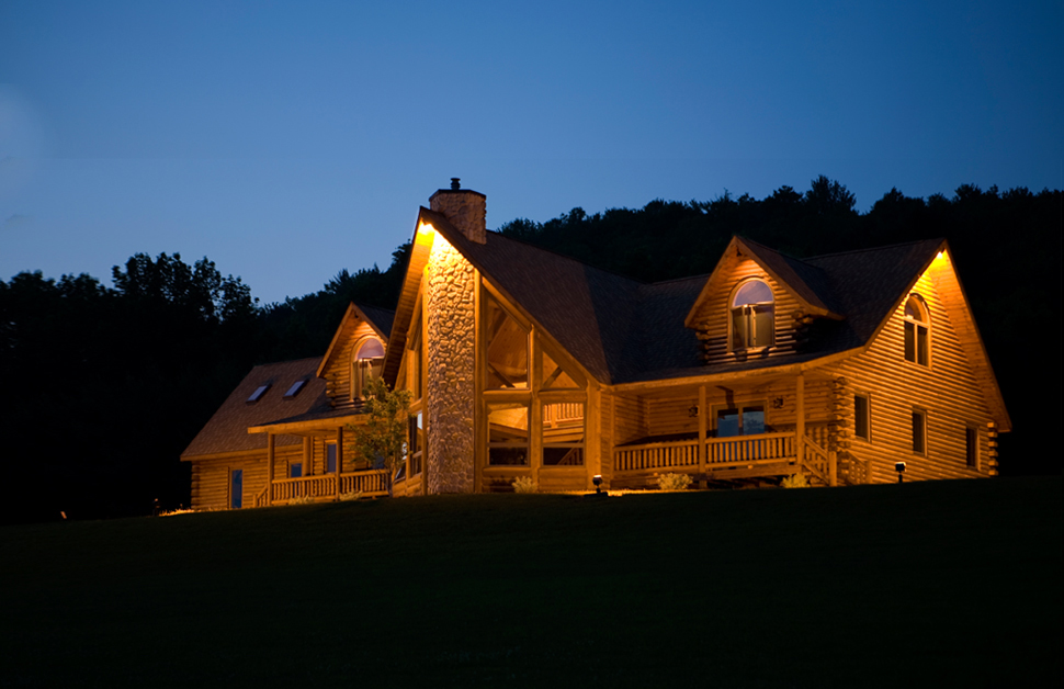 Beaver Mountain Log Homes Grandview Model Home Exterior Night